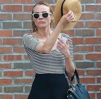 Diane Kruger a sair do seu hotel